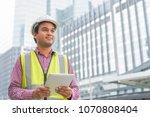 engineer with hardhat is...   Shutterstock . vector #1070808404