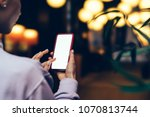 woman's hands holding mobile... | Shutterstock . vector #1070813744