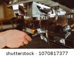 the barista in the coffee shop... | Shutterstock . vector #1070817377