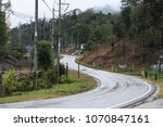 sharp curve concrete road with... | Shutterstock . vector #1070847161