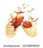 dried peanuts  broken into two... | Shutterstock . vector #1070899859