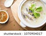 rice porridge with fish. | Shutterstock . vector #1070904017