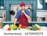 man cook secret dish in kitchen.... | Shutterstock . vector #1070905079