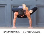 man doing yoga exercises and... | Shutterstock . vector #1070920601