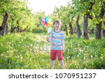 portrait of a happy cute little ... | Shutterstock . vector #1070951237