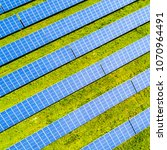 aerial view of solar panels.... | Shutterstock . vector #1070964491