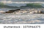 rocky seashore with wavy ocean... | Shutterstock . vector #1070966375