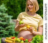 a pregnant woman in a yellow t...   Shutterstock . vector #1070966699