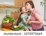mother and daughter with basket ...   Shutterstock . vector #1070975669