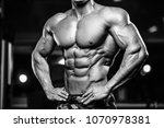 handsome young fit muscular... | Shutterstock . vector #1070978381