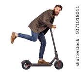bearded man holding the... | Shutterstock . vector #1071018011