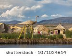 uros floating island  lake... | Shutterstock . vector #1071024614