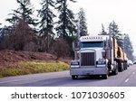 big rig classic powerful semi... | Shutterstock . vector #1071030605