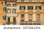 aged vintage building facade... | Shutterstock . vector #1071061241