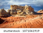 colorful sunset at white pocket ... | Shutterstock . vector #1071061919