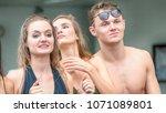 sexy people on swimming wear... | Shutterstock . vector #1071089801