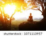 serenity and yoga practicing... | Shutterstock . vector #1071113957
