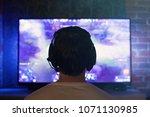 gamer or streamer in earphones...   Shutterstock . vector #1071130985