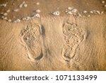 sand dunes  footprints on the... | Shutterstock . vector #1071133499