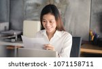 young asian business woman... | Shutterstock . vector #1071158711