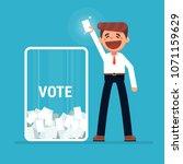vote  man voting at ballot box. | Shutterstock .eps vector #1071159629