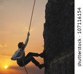 Business Man Climbs A Mountain