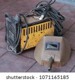 """Small photo of City of Zavodoukovsk, Tyumen region, Russia, August 16, 2017: Welding apparatus """"Anode"""" and mask. Manufacture of the USSR."""