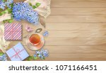 lilac on wooden background.... | Shutterstock .eps vector #1071166451
