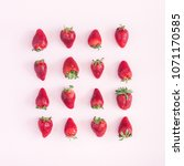 strawberry pattern on pink... | Shutterstock . vector #1071170585