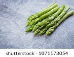 Fresh Green Asparagus On Gray...