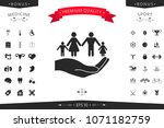 hand holding a symbol of family.... | Shutterstock .eps vector #1071182759