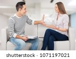 unhappy sad couple sitting on... | Shutterstock . vector #1071197021