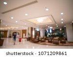 luxury hotel lobby blurred... | Shutterstock . vector #1071209861