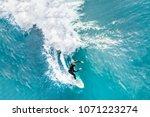 surfer in the ocean  top view | Shutterstock . vector #1071223274