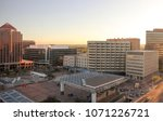 View of Downtown Albuquerque skyline, Civic Plaza, offices and government buildings. Early evening in springtime.