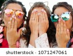 close up of three young girls... | Shutterstock . vector #1071247061