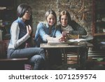 students girls in library using ... | Shutterstock . vector #1071259574