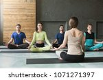 yoga teacher and beginners in...   Shutterstock . vector #1071271397