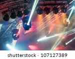 multiple spotlights on a theatre stage lighting rig - stock photo