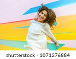 joyful young woman on the... | Shutterstock . vector #1071276884
