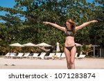 a young woman in blue lagoon in ... | Shutterstock . vector #1071283874