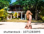 a young woman in blue lagoon in ... | Shutterstock . vector #1071283895