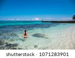 a young woman in blue lagoon in ... | Shutterstock . vector #1071283901