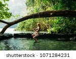 a young woman in blue lagoon in ... | Shutterstock . vector #1071284231