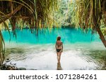a young woman in blue lagoon in ... | Shutterstock . vector #1071284261