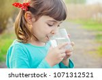 child glass of water. selective ... | Shutterstock . vector #1071312521