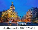 car and traffic lights on gran... | Shutterstock . vector #1071325631