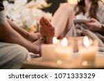 woman having reflexology foot... | Shutterstock . vector #1071333329