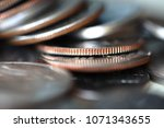 close up of coins pile | Shutterstock . vector #1071343655