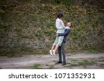 woman being carried by her... | Shutterstock . vector #1071352931